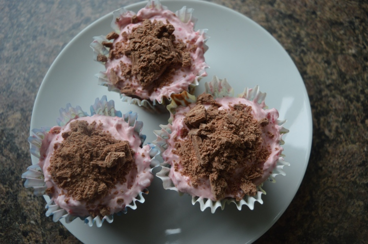 Chocolate cupcakes with raspberry mascarpone icing